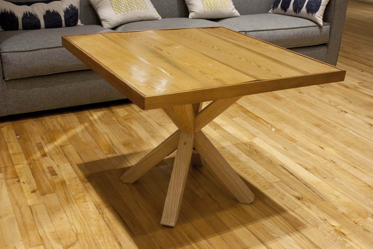 Custom coffee table tops made of reclaimed pickle barrel wood