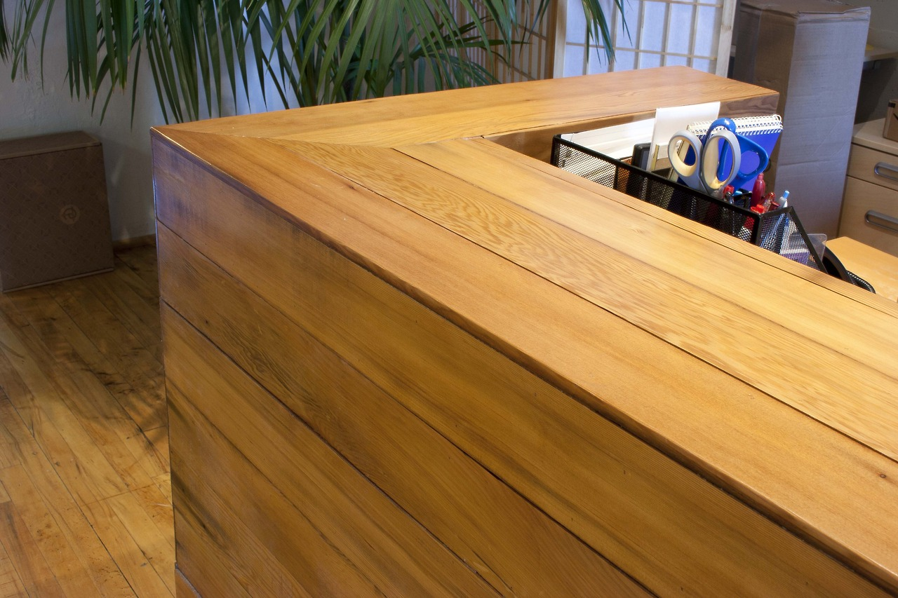 ... . Reception desk made of wood salvaged from reclaimed pickle barrels
