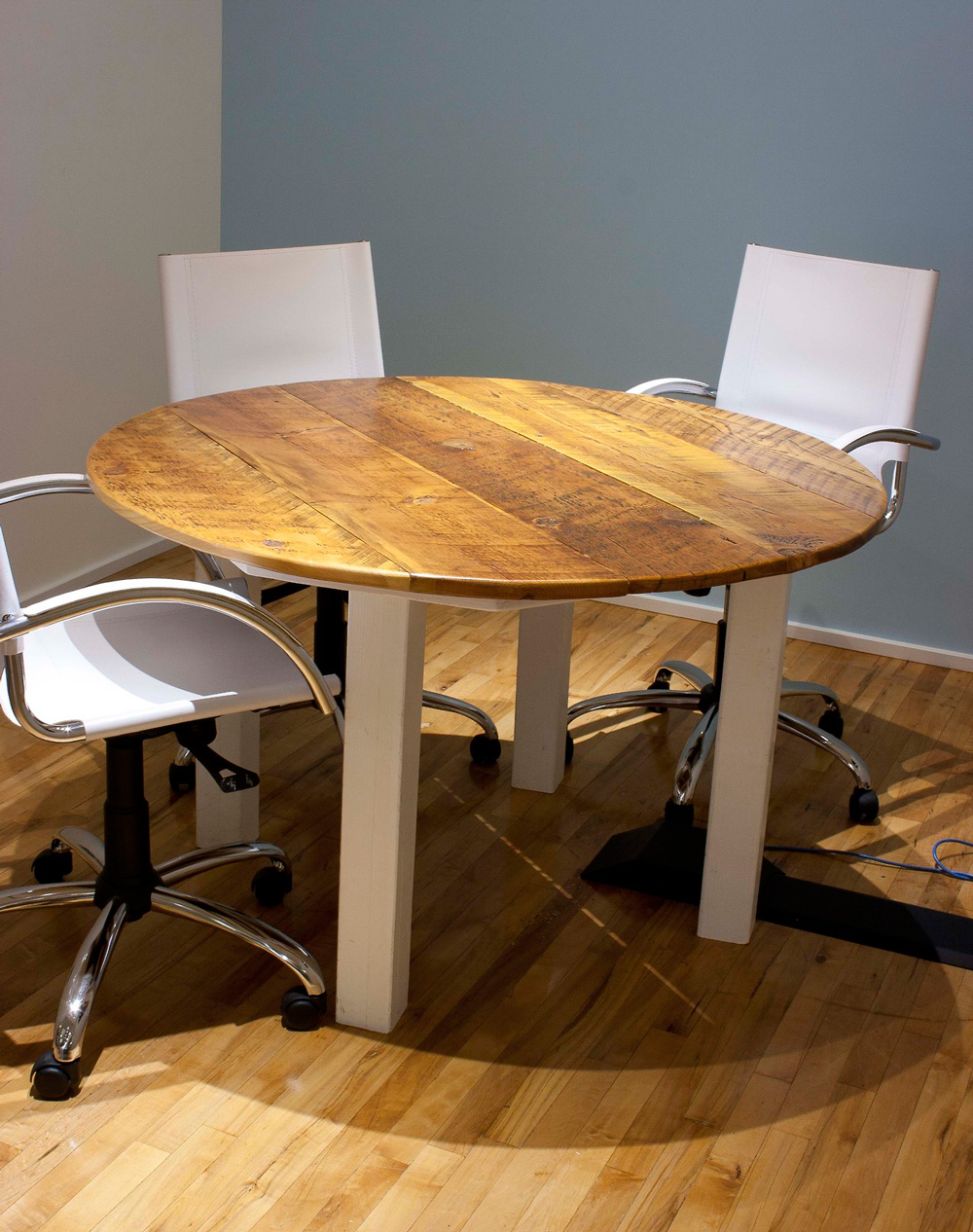 Round conference room table made of reclaimed wood